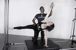 Anna Tetlow practicing Garuda with James D'Silva. Photo courtesy of Tetlow.