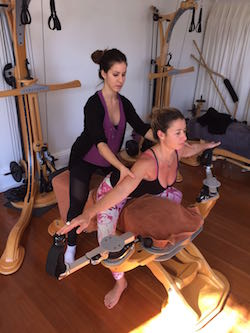 Lisa Mathison instructs Juliana Bianchi in the Gyrotonic method. Photo courtesy of Bianchi.
