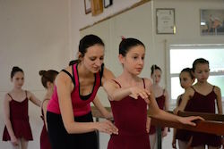 Alexandra Cownie corrects a ballet student. Photo courtesy of Cownie.