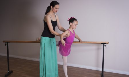Alexandra Cownie working with a young ballet dancer. Photo courtesy of Cownie.