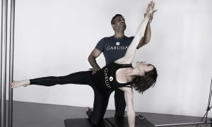 Anna Tetlow being trained by The Garuda Method founder, James D'Silva. Photo courtesy of Tetlow.