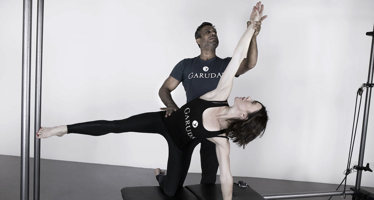 Anna Tetlow being trained by The Garuda Method founder, James D'Silva. Photo courtesy of Tetlow.