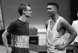 Callum Mansfield giving direction to Barry Conrad (Kenickie) in rehearsals. Photo by Nick Morrissey Photography