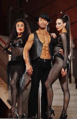Travis Khan (center).